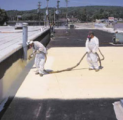 Workers spraying roof for Commercial Roofing in Staunton, Virginia