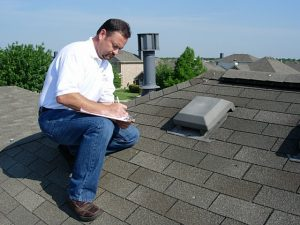 Licensed Roof Inspector in Staunton, Virginia taking notes on a residential roof.